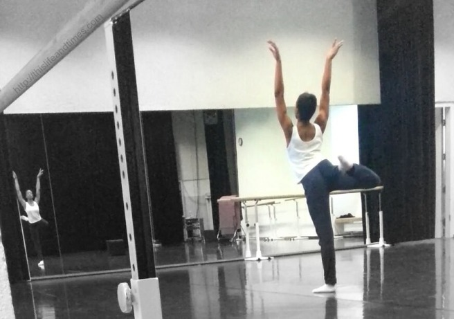 Dancer in the studio, dancing in front of a large mirror