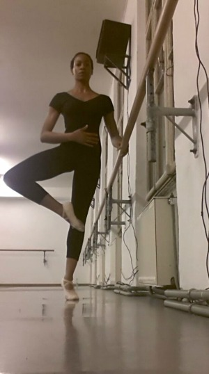 Ballerina at the barre standing on one leg